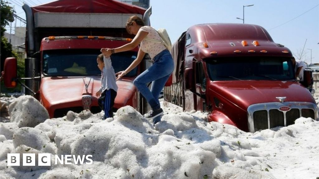 Ice 1.5m thick as Mexican city hit by freak hail thumbnail