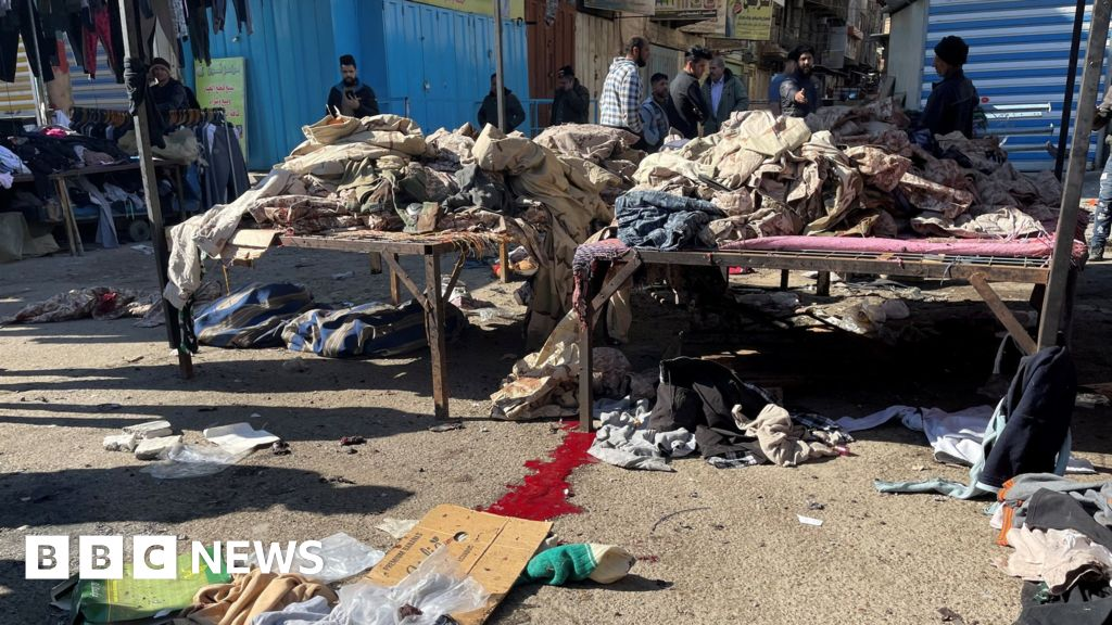 Iraq assault: Twin suicide bombings in central Baghdad kill 13