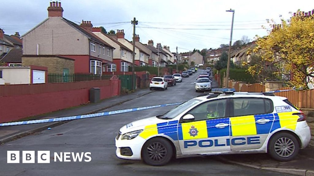 Four charged over Huddersfield shooting death