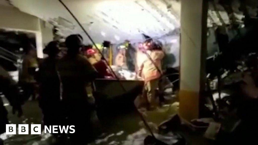 Survivor search under collapsed Miami building