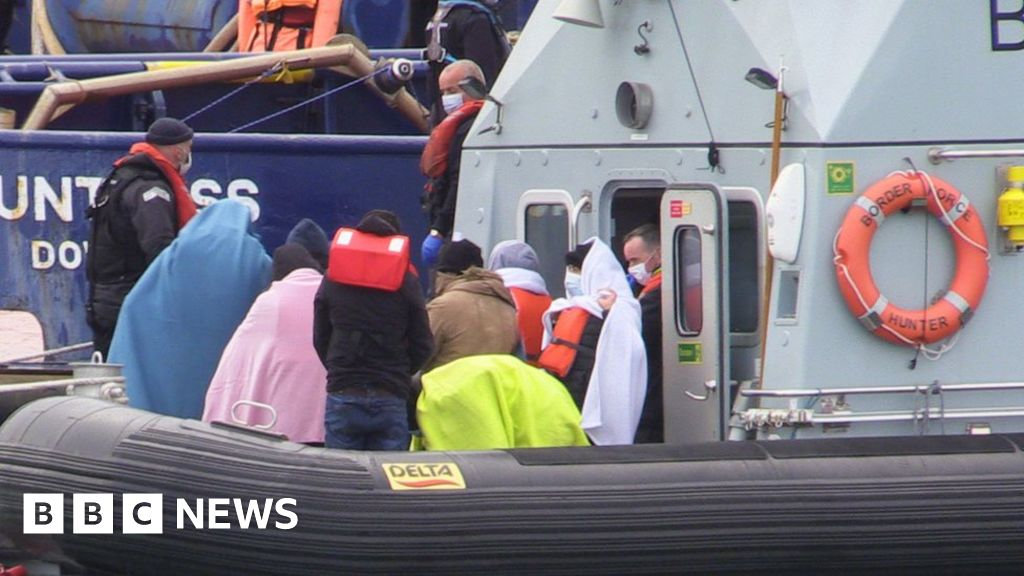 Dozens of migrants cross English Channel in 12 boats