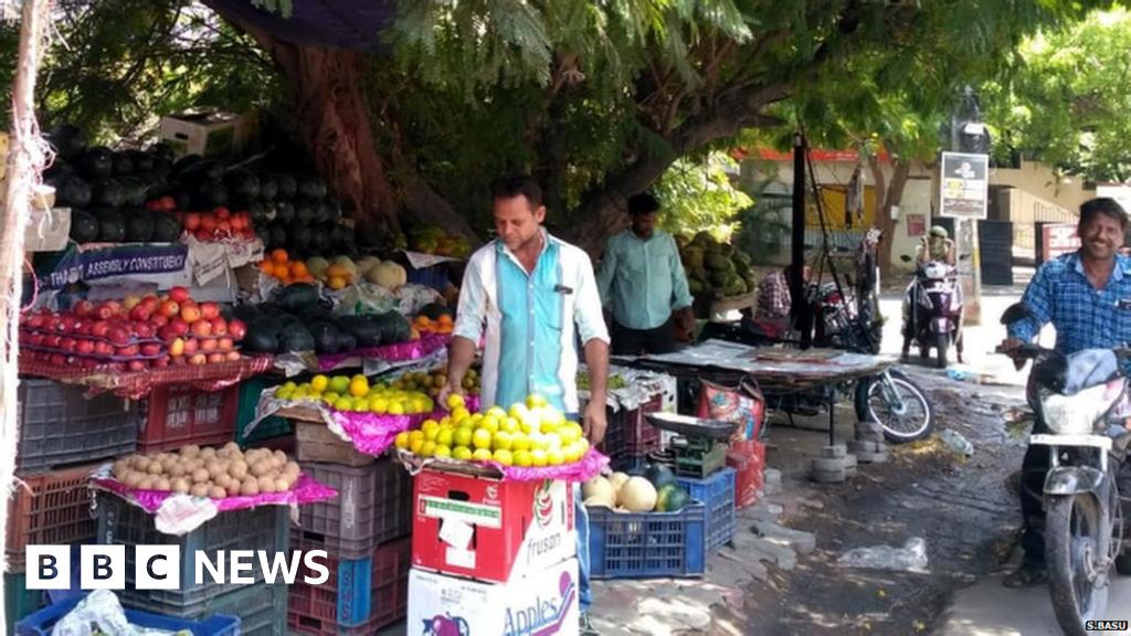 Street merchants shedding 'proper to shade' underneath timber thumbnail