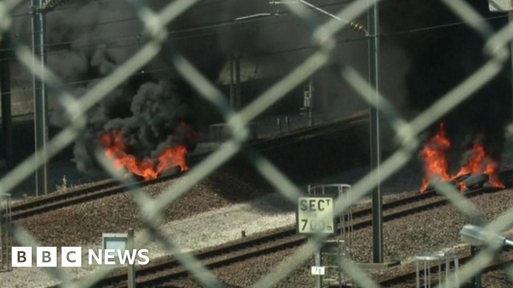 Burning tyres on Eurotunnel tracks near Calais