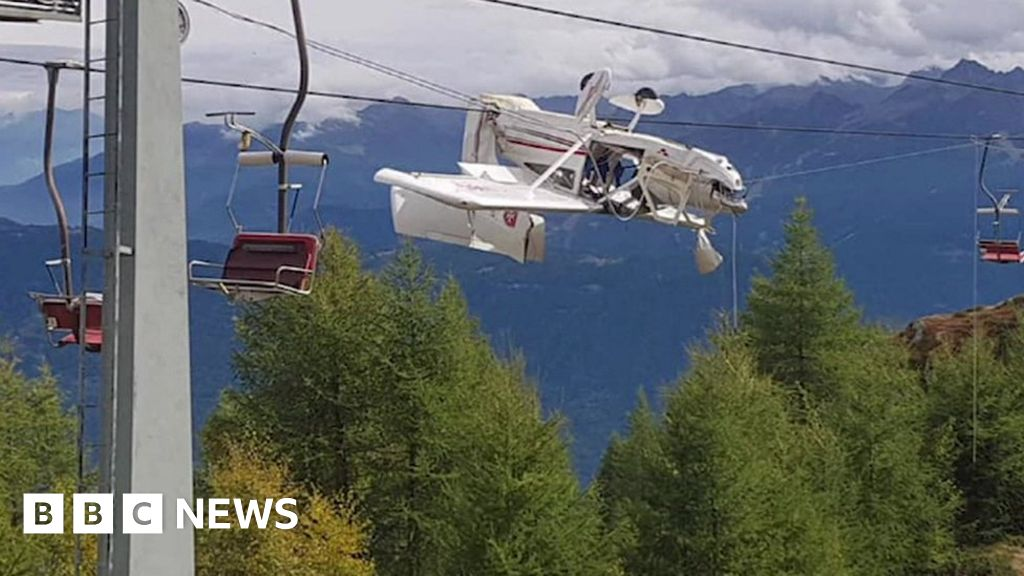 Plane left entangled in ski lift cables in Italian Alps after crash