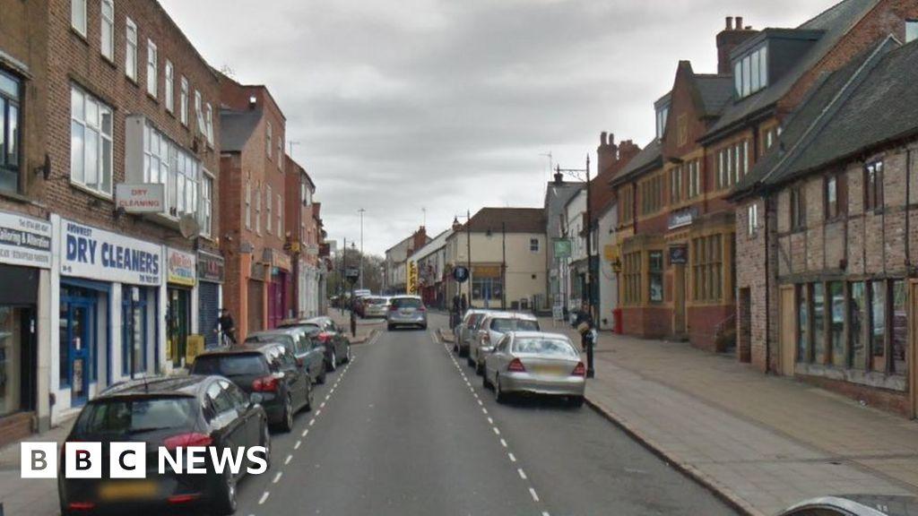 Men injured as shotgun fired at car