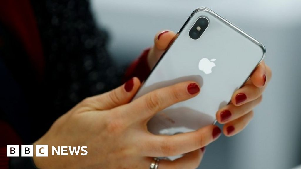 Apple blames China as it cuts forecast