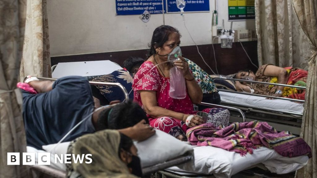 India says infections 'slowing down' as it passes 20 million cases