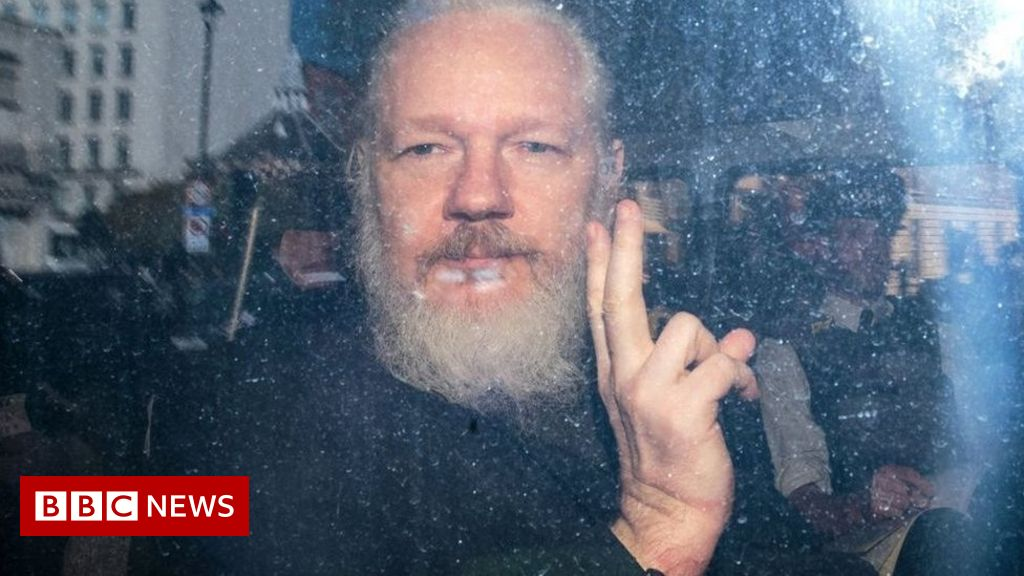 Assange used embassy for 'spying' - Ecuador