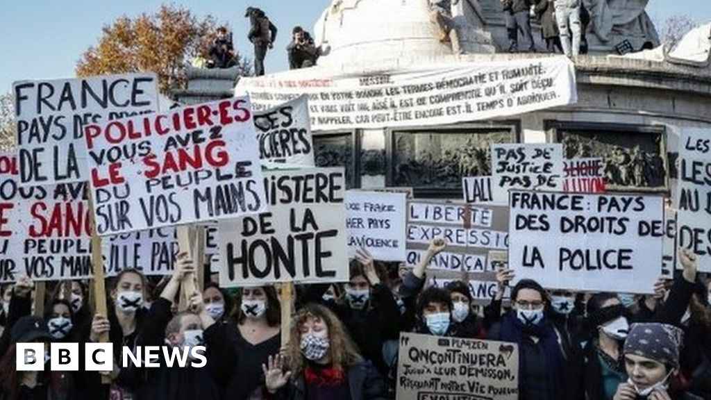 France: Tear gas fired as protesters rally against police security bill