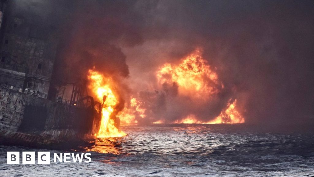 Four oil slicks seen around sunken tanker