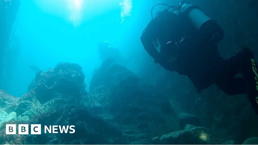 Diving under Dorset's Durdle Door