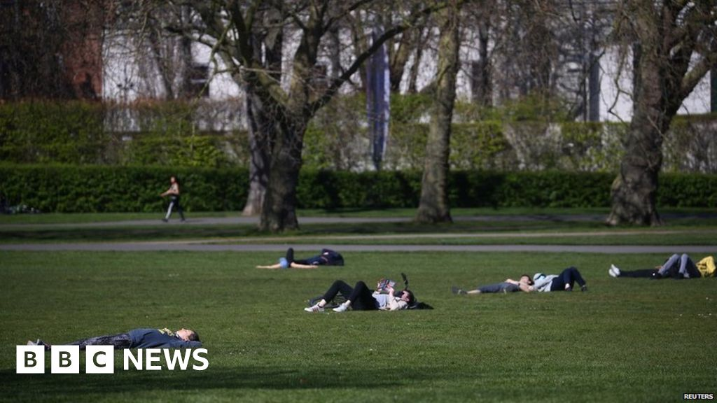 Sunbathing 'against virus social distancing rules'