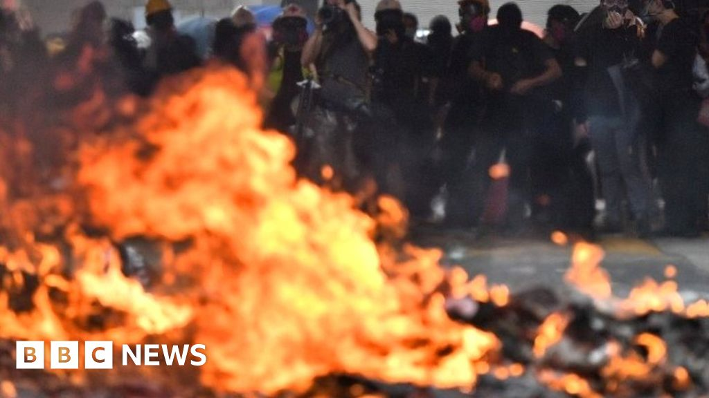 China anniversary: Clashes as Hong Kong protesters defy police ban