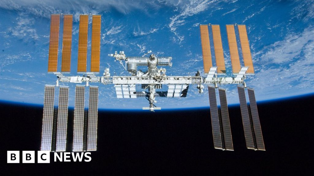 Space station crew woken up to hunt for air leak - BBC News