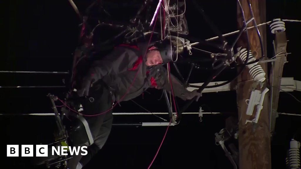 Paraglider hangs for hours in power lines