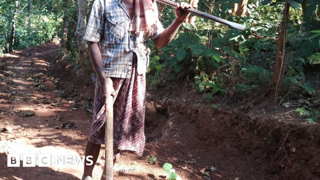 Man builds road to village with pick axe