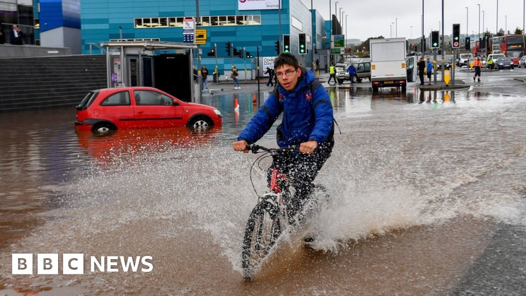 England weather: heavy rain causes flooding chaos and travel