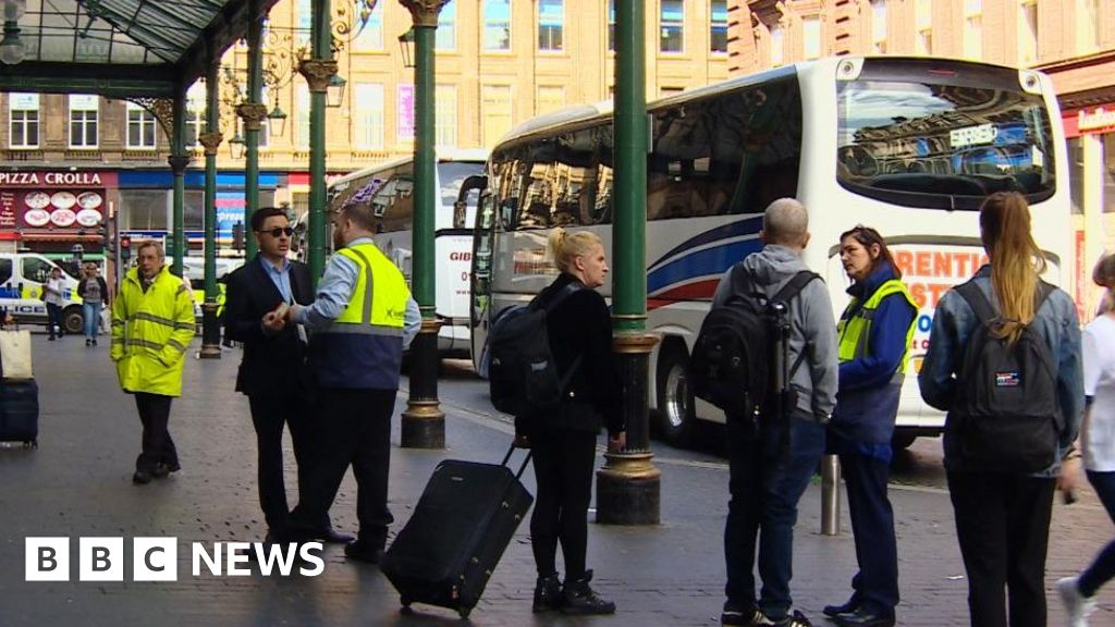 Passengers and ScotRail staff outside Glasgow Central station