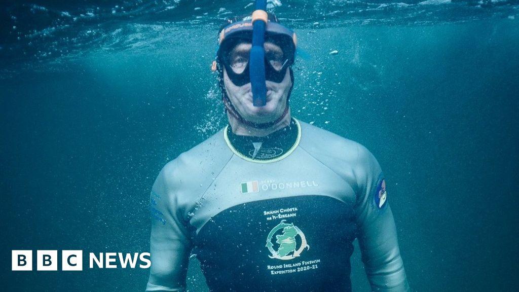 The man swimming around the coast of Ireland