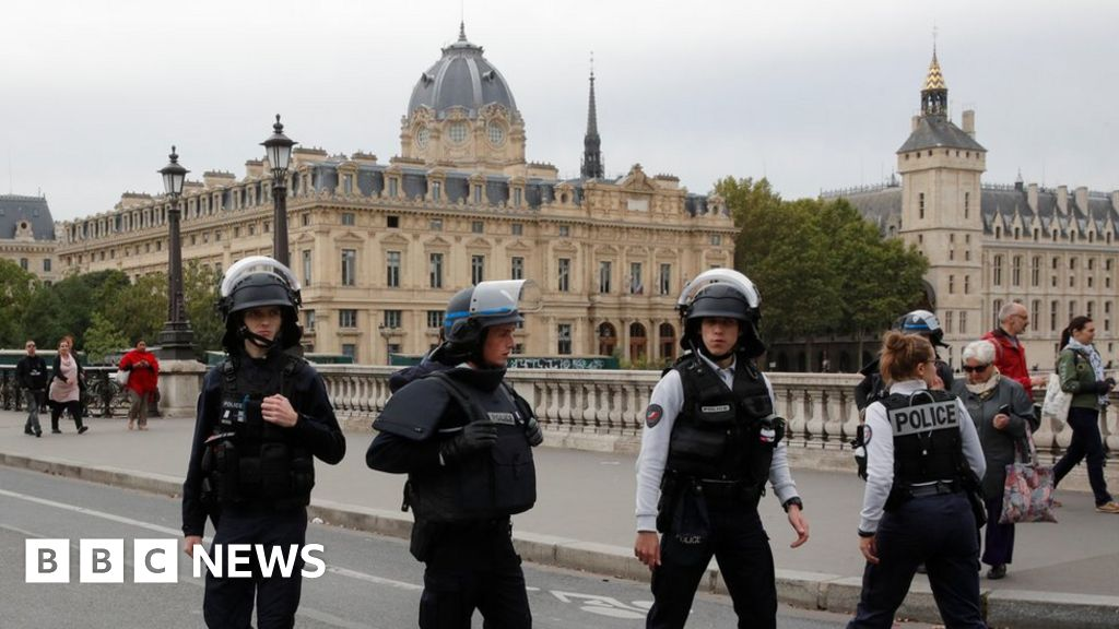 Man shot dead after knife attack on Paris police