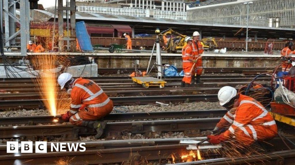 Railway workers completing engineering work