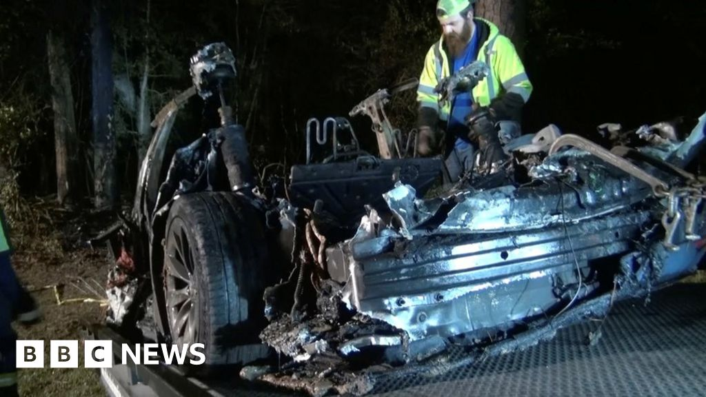 Two men killed in Tesla car crash 'without driver' in seat