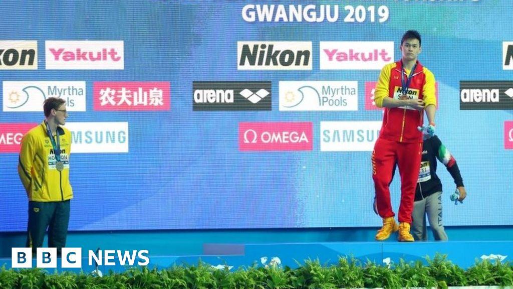 Australian swimmer refuses to join rival on podium thumbnail