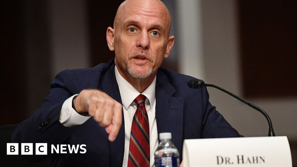 Coronavirus: FDA chief refuses to back Trump's vaccine prediction thumbnail