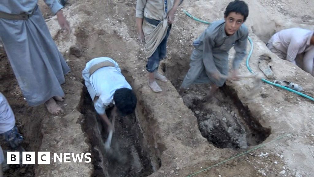 Boys dig friends' graves after air strike