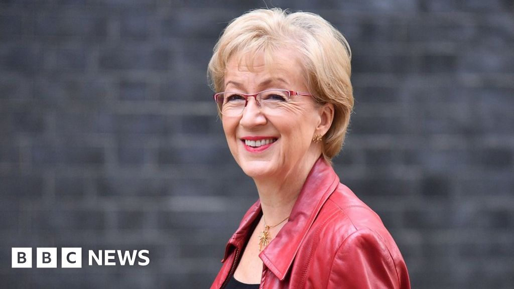 May faces pressure after minister resigns