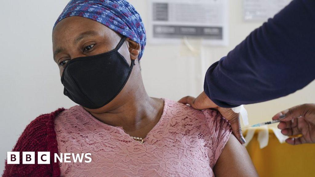 UK Covid vaccine rules cause hesitancy - Africa health boss - BBC News
