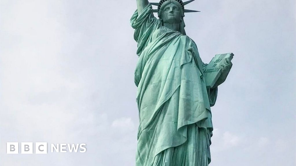 Refugees Welcome Banner Hung On Statue Of Liberty In New York Bbc