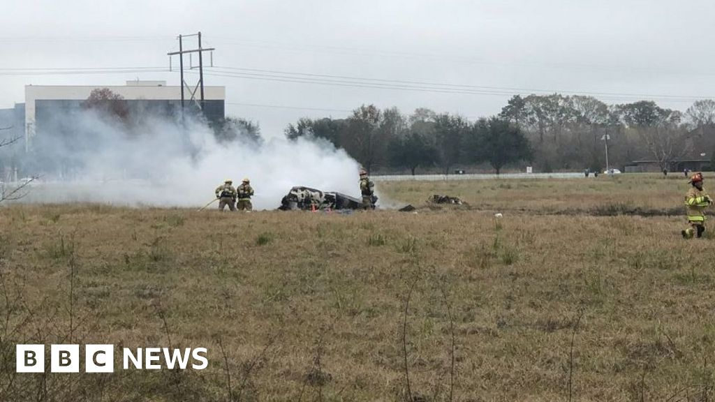 Five dead as plane crashes behind Walmart store