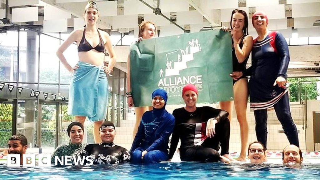 Muslim women defy ban to swim in burkinis at French pool