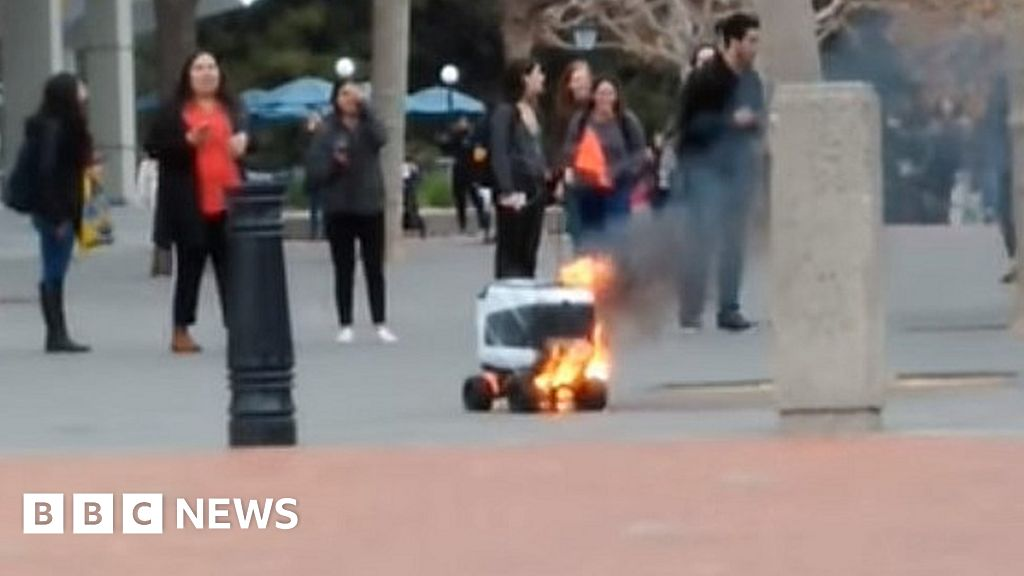 Delivery robot catches fire in California