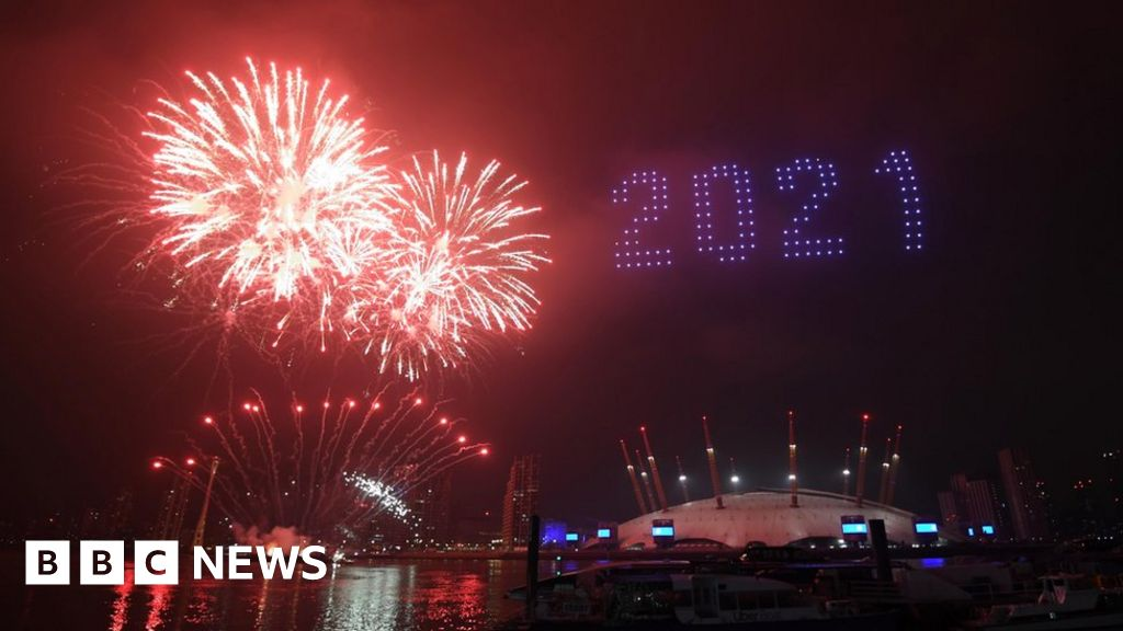 New Year's Eve: UK sees in 2021 with fireworks and light show