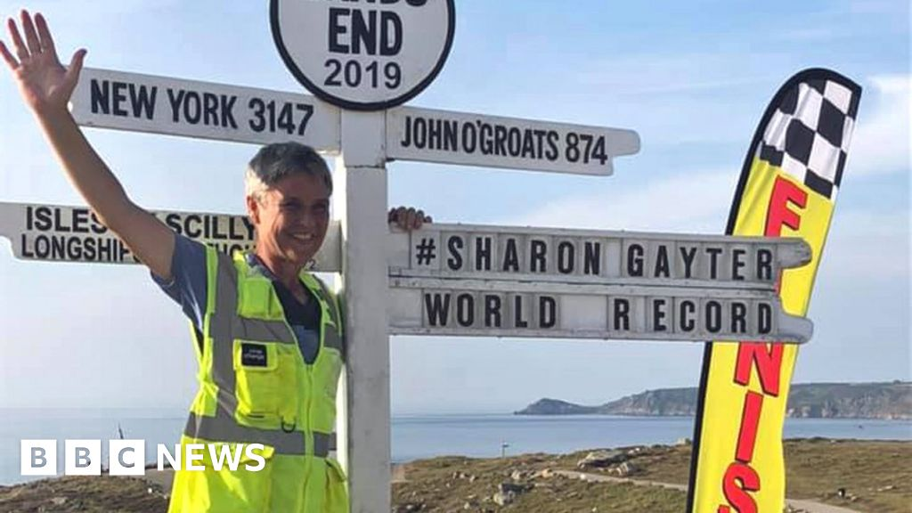 Woman, 55, sets John O'Groats to Land's End running record - BBC News