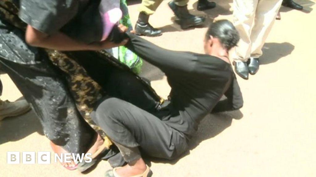 Ugandan police confront female protesters - BBC News