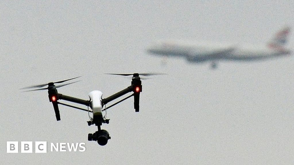 Heathrow drone protest: Two held over climate change action - BBC News