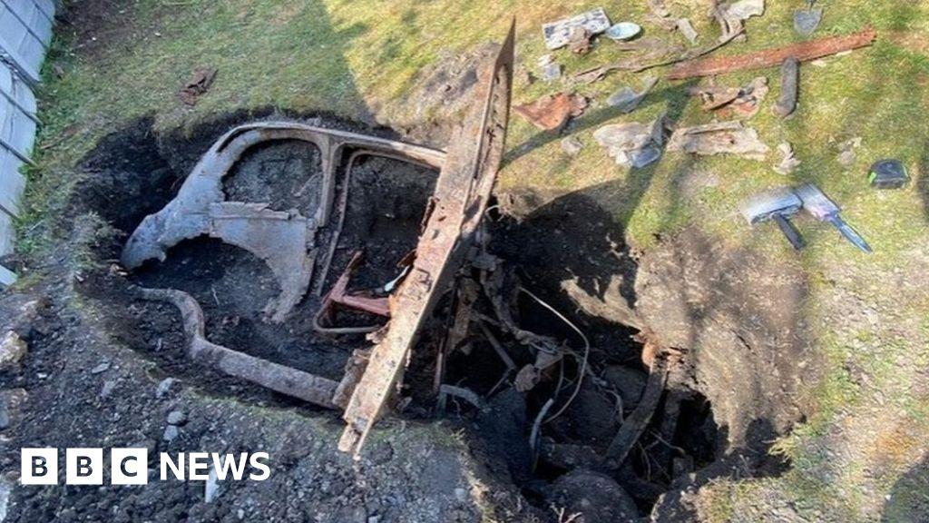 Coronavirus: Man finds old car buried in garden during lockdown ...