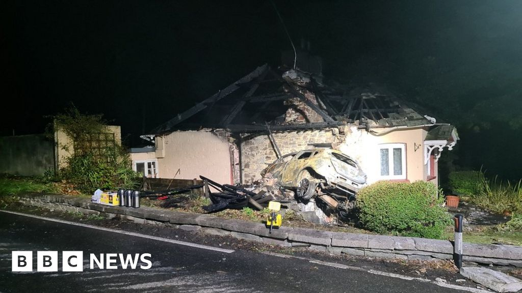 A38 crash: Arson arrest after car crashes into house