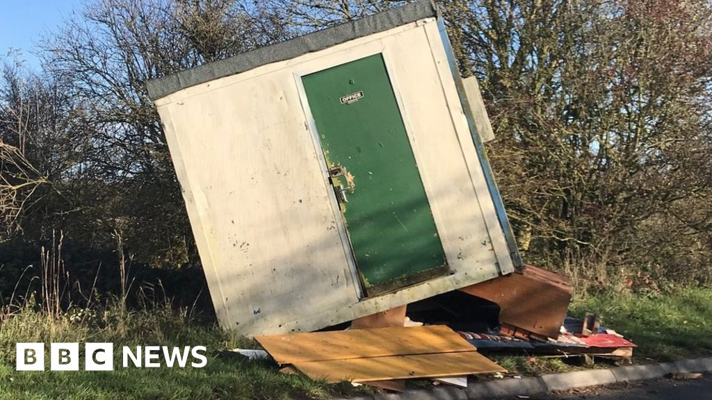 Office filled with furniture dumped in Wiltshire lane