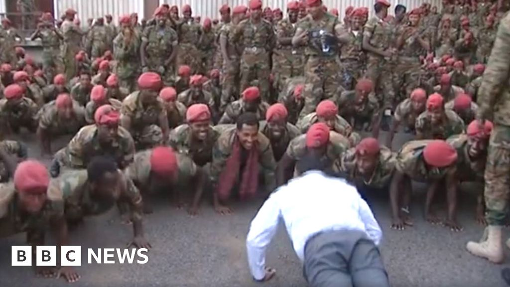 Ethiopia Prime Minister Abiy Ahmed does press-ups with protesting soldiers