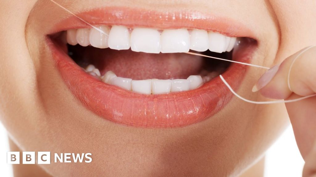 Should you floss or not? Study says benefits unproven - BBC News