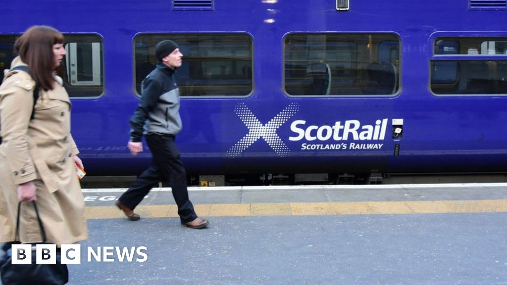 ScotRail trains operated by Abellio arrive and depart for Glasgow Central station on December 5, 2016