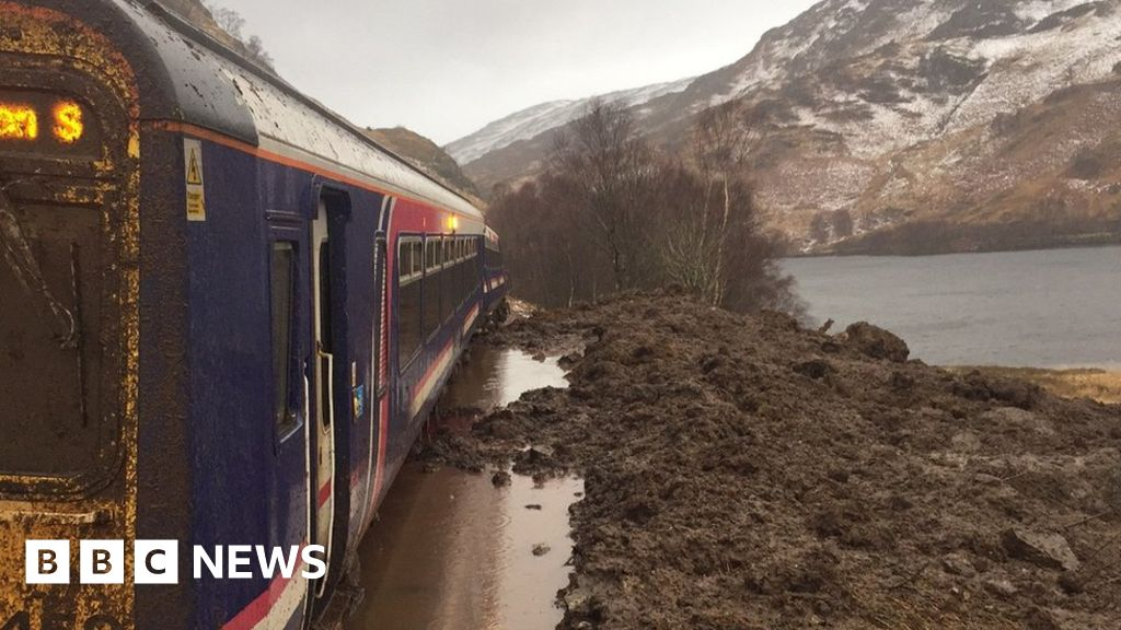 Train trapped in landslide