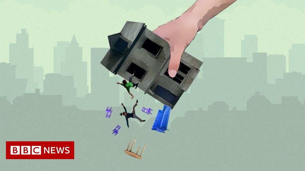 House upside down with people falling out