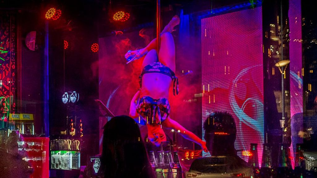 Why do some Chinese funerals involve strippers?