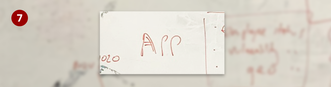 Whiteboard excerpt - the word 'APP' written in the middle of the board