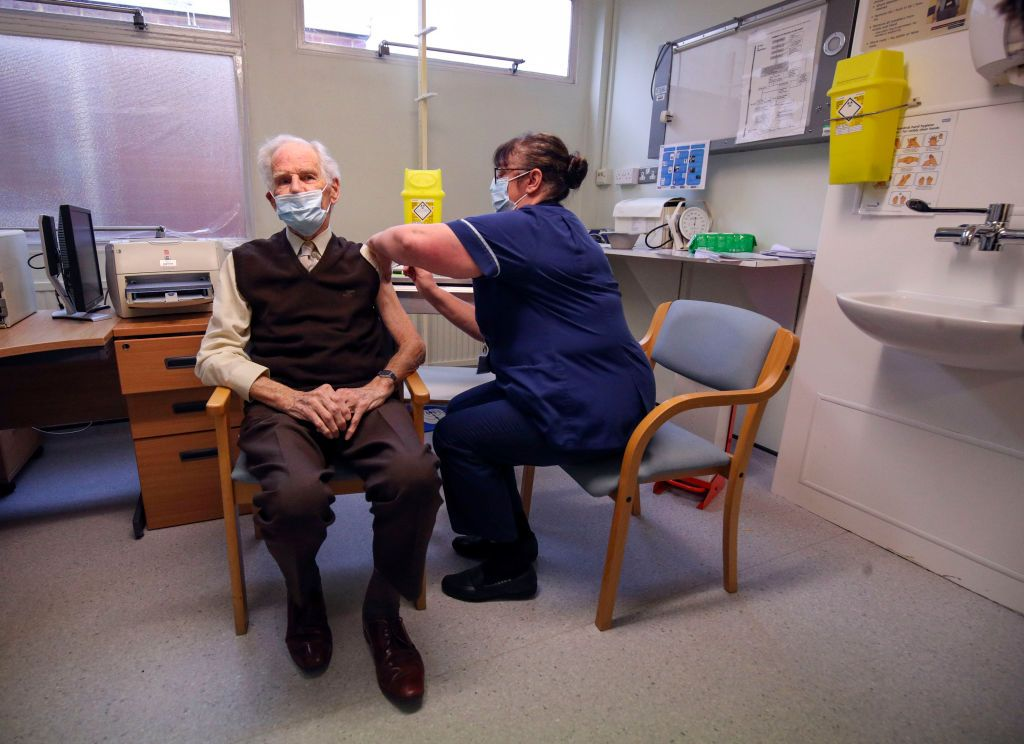 Brian Horne gets the vaccine from a nurse in a GP's surgery in Chalfont St Peter